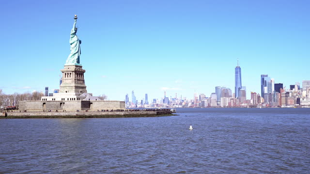 Statue of Liberty - New York City, New York, Shot from ferry leaving fromLiberty Island. NYC landmark tourism concept.