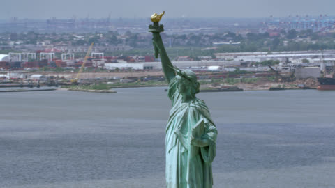 AERIAL Statue of Liberty, New York Aerial shot of the Statue of Liberty, New York. Shot in USA. aircraft point of view stock videos & royalty-free footage