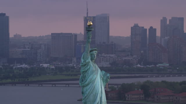 Statue of Liberty on beautiful cloudy morning. New York City circa-2017, Statue of Liberty on beautiful cloudy morning.   Shot with Cineflex and RED Epic-W Helium. statue stock videos & royalty-free footage