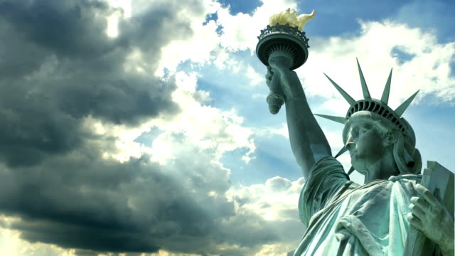 Statue of Liberty A time lapse of Statue of Liberty on a bright sunny afternoon. statue stock videos & royalty-free footage