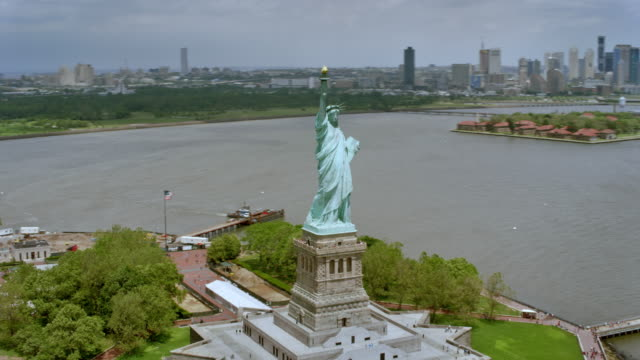 AERIAL Statue of Liberty with Liberty Island on a sunny day