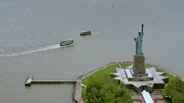 AERIAL Statue of Liberty with New York Harbor video