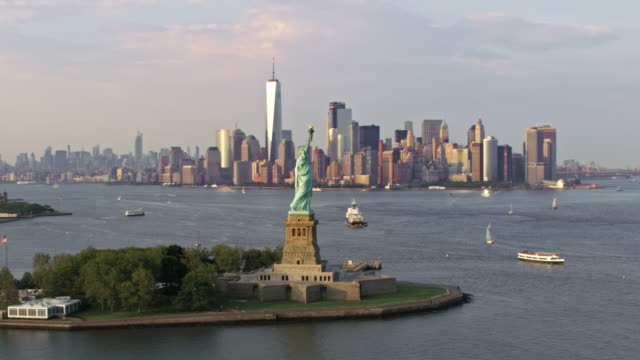 aerial statue of liberty with the freedom tower in the background - american architecture stock videos & royalty-free footage