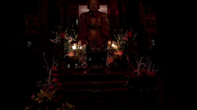 Statue of medieval Vietnamese Emperor in Pagoda. Hanoi, Vietnam video