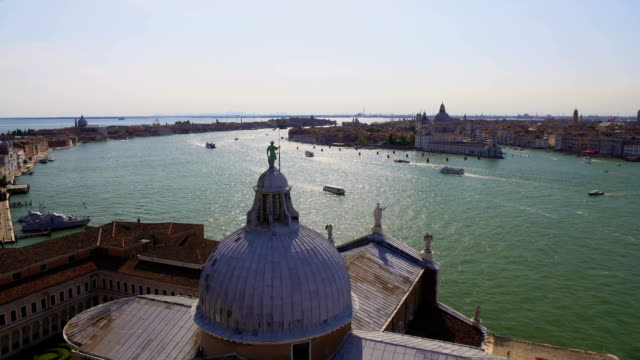 Statue of St. George standing on dome of cathedral, view of Grand Canal, Venice video