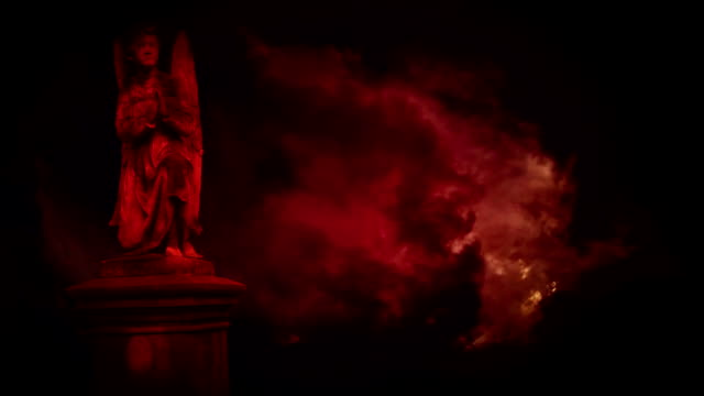 Statues of angels in the red storm. video