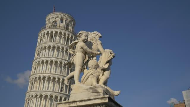 statues on the fontana dei putti, pisa - pisa video stock e b–roll