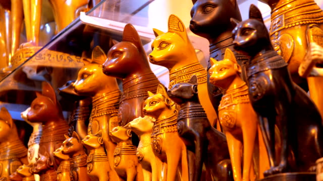 Statuettes of Egyptian Cats of Stone and other Products on Store Shelves in Egypt