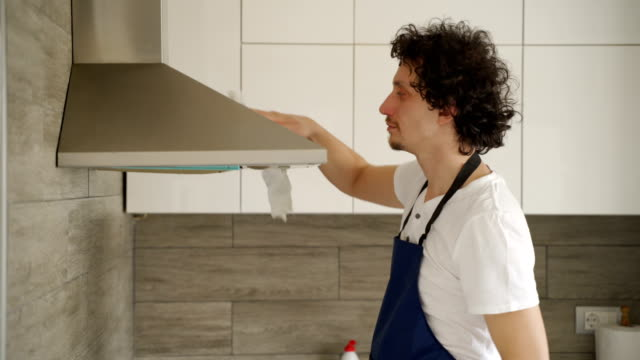 Stay at home father cleaning a kitchen video
