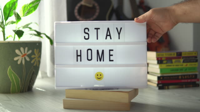 Stay Home Message on a LED Lightbox. Motivational Positive thinking concept. video