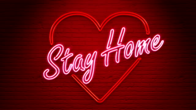 stay home neon nachricht an der wand - krankheitsverhinderung stock-videos und b-roll-filmmaterial