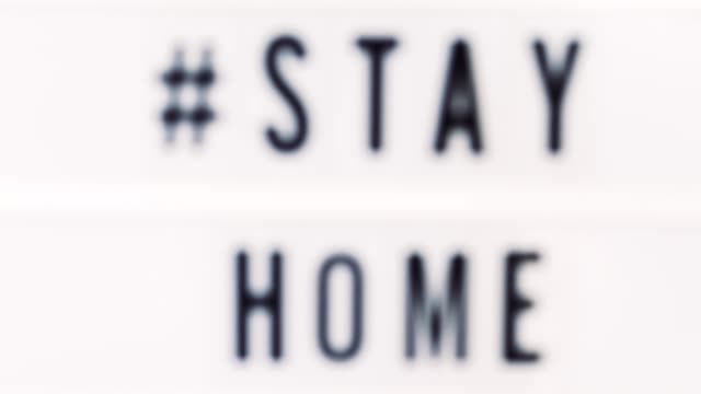vídeos y material grabado en eventos de stock de stay home escrito en un texto de cuadro de luz. concepto de coronavirus. cuarentena y aislamiento. nuevo coronavirus. (2019-ncov). covid-19. - stay home