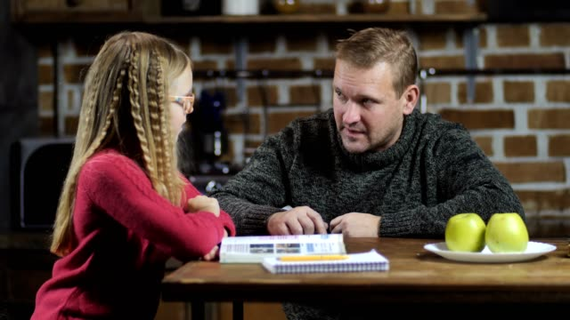 Stay-at-home dad helping daughter with studies video