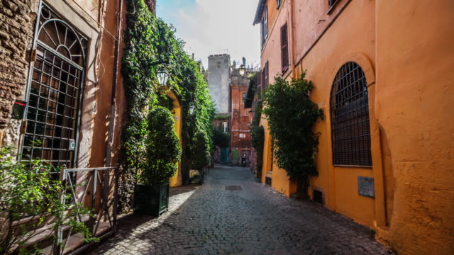 steadicam: idyllic narrow street in rome, trastevere - italian architecture stock videos & royalty-free footage