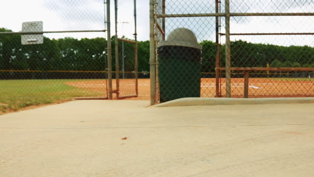Steadicam shot of a baseball field taken from behind fence video