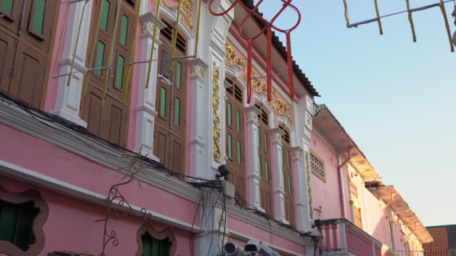 Steadicam shot of historical buildings in an old part of Phuket town, Phuket island, Thailand. Travel to Thailand concept