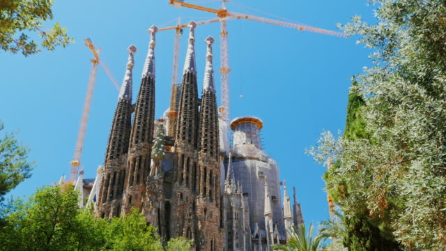 steadicam shot: the famous temple of the sagrada familia in barcelona, the camera moves in the direction of the church - church architecture stock videos & royalty-free footage