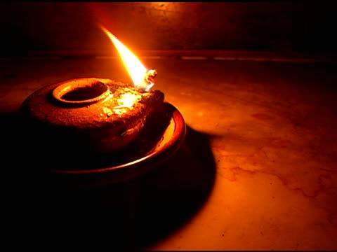 Steady on Oil Lamp Burning in Dark Room video