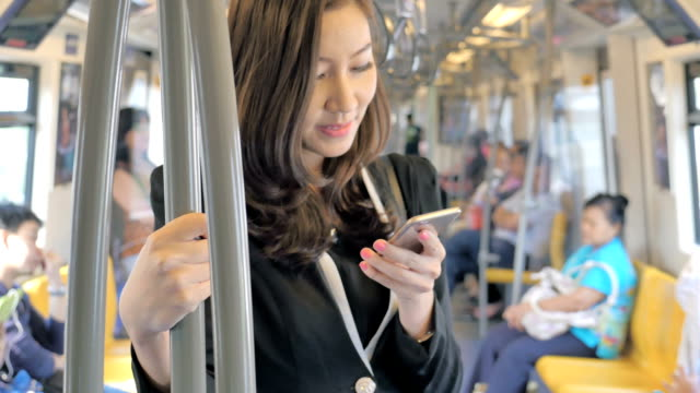 steadycam shot of businesswoman using smartphone on train,close-up - train stock videos and b-roll footage