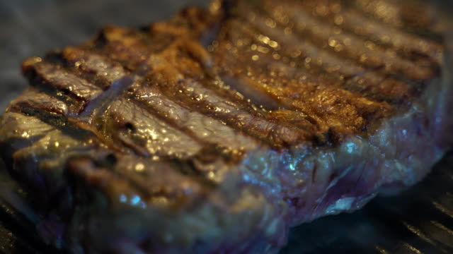 Steak cooking on griddle pan, searing meat Steak cooking on griddle pan, searing meat seared stock videos & royalty-free footage