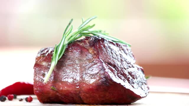 steak, rosemary and chili pepper. - filetto video stock e b–roll