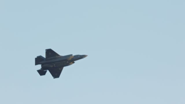 F-35 Stealth fighter performing high speed combat maneuvers