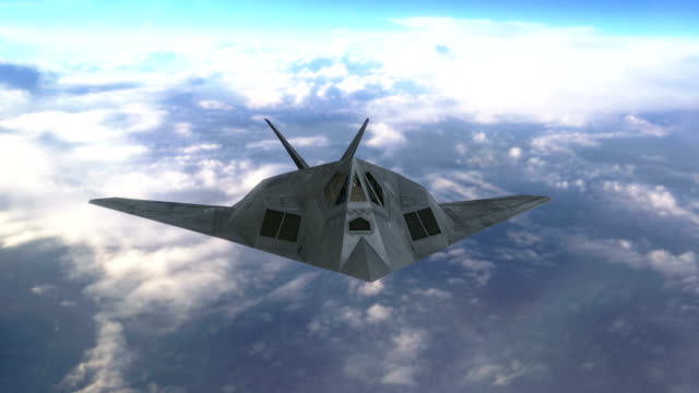 Stealth jet aircraft flying above clouds video