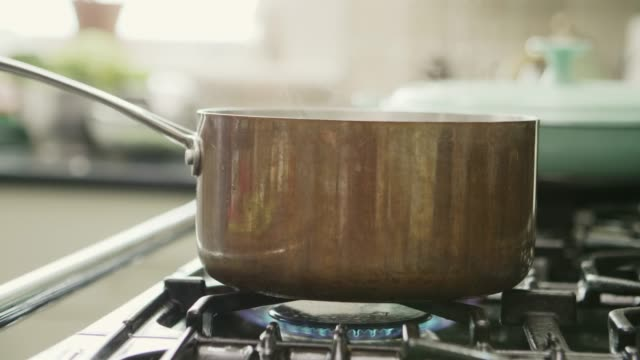 Steam Blowing From Container On Stove In Kitchen video