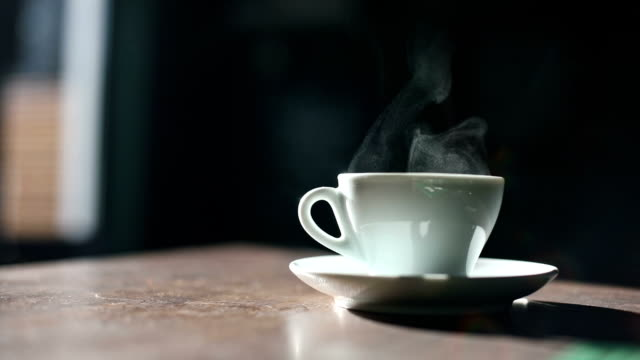 Steam coming out of a coffee cup Color footage of some steam coming out of a coffee cup. mug stock videos & royalty-free footage
