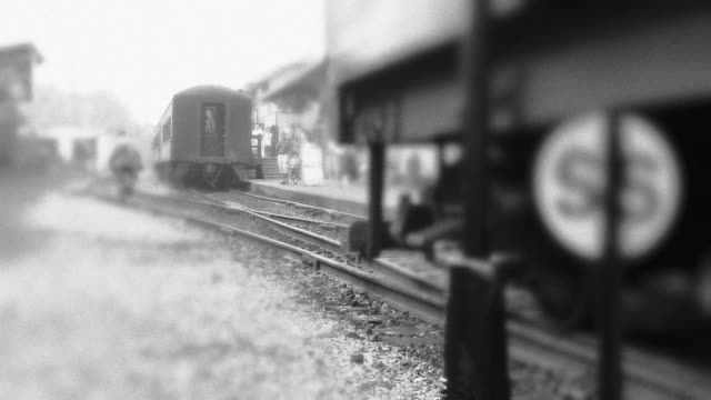 Steam Engine Train Backs Up to Station  black and white architecture stock videos & royalty-free footage