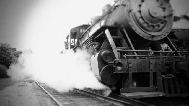 steam engine train leaves station - bw - train stock videos and b-roll footage