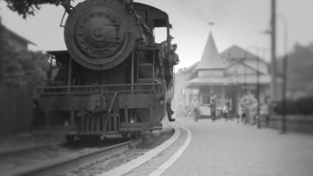 steam engine train leaves station - train stock videos and b-roll footage