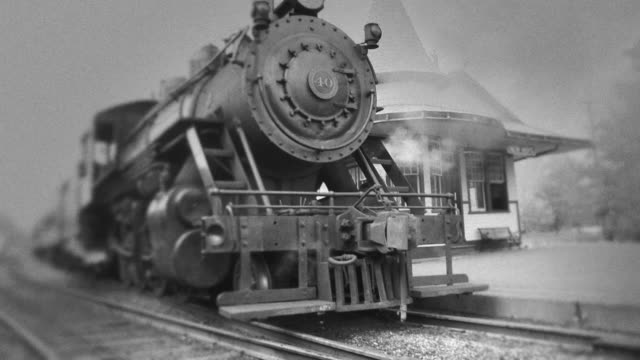 Steam Engine Train Waits at Station #3 - BW video