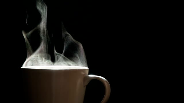 steam from a mug with a hot drink - bevanda calda video stock e b–roll