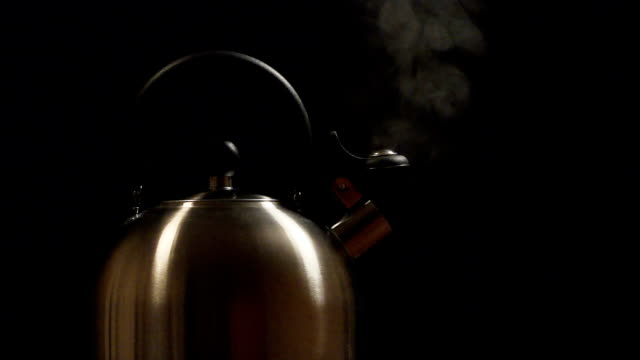 slow: steam from a steel kettle on a black background - teapot stock videos & royalty-free footage