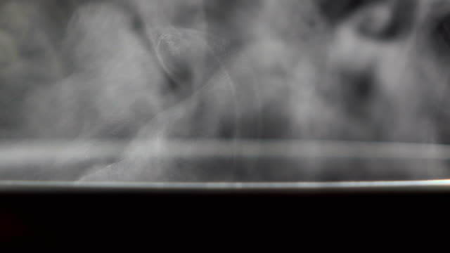 Steam from Boiling water in coating pan Steam from Boiling water in coating pan heating on electronic stove boiled stock videos & royalty-free footage