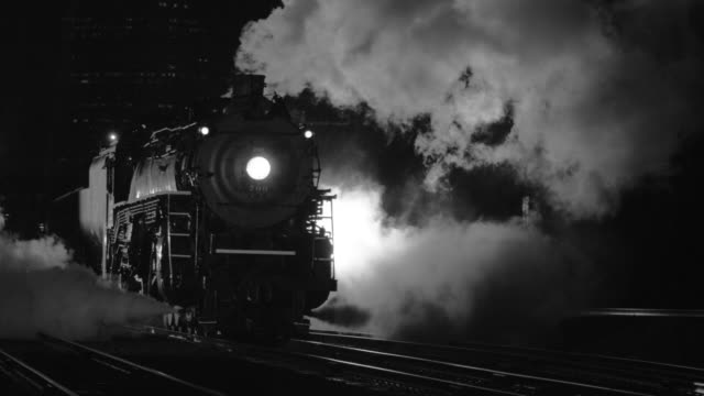 Steam locomotive at night in black and white