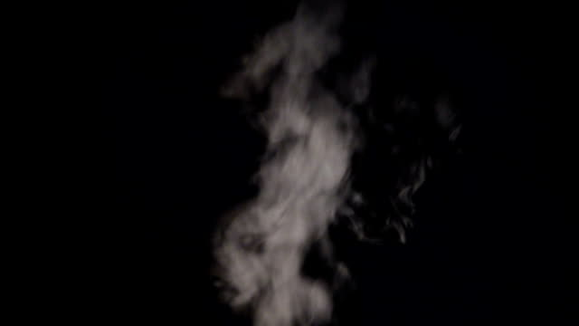Steam on black background Steam on black background. steam stock videos & royalty-free footage