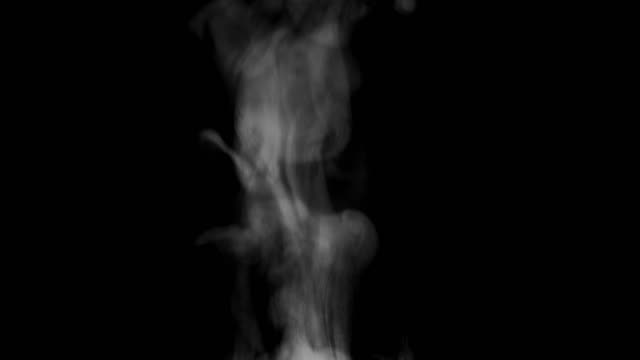 Steam on black background Hot rising steam shot on a black background in 4K resolution. steam stock videos & royalty-free footage
