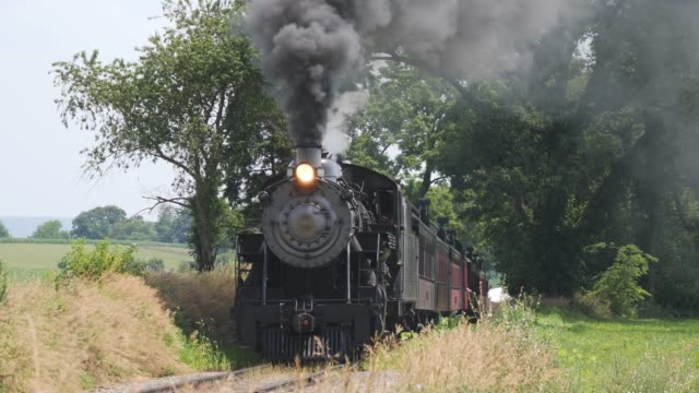 Steam Train Puffing Along Amish Countryside