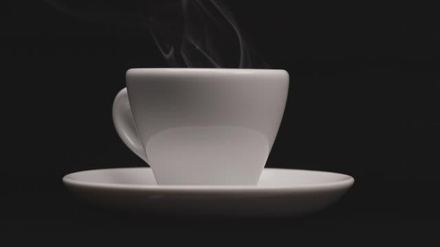 steaming coffee cup on dark background - espresso filmów i materiałów b-roll