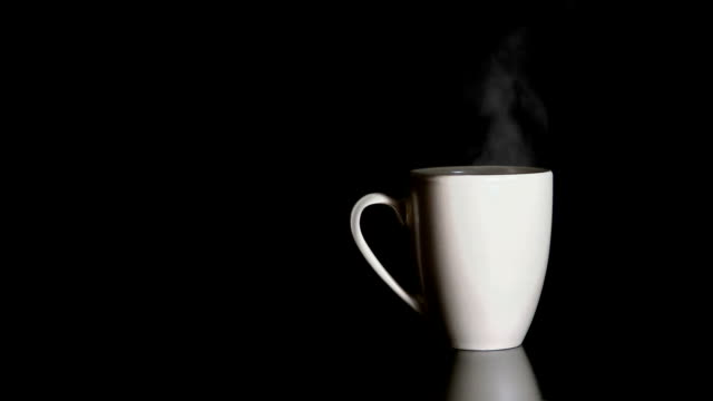 Steaming Cup Continuous loop of steam rising from a cup with a hot drink. mug stock videos & royalty-free footage