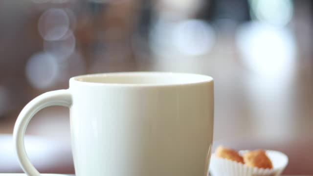 Steaming Hot coffee drink in coffee shop, cafe Steaming Hot coffee drink in coffee shop, cafe mug stock videos & royalty-free footage