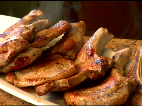 Steaming Pork Chops on plate. video