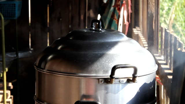 Steaming pot Steam coming off the lid of the steaming pot on the stove. lid stock videos & royalty-free footage