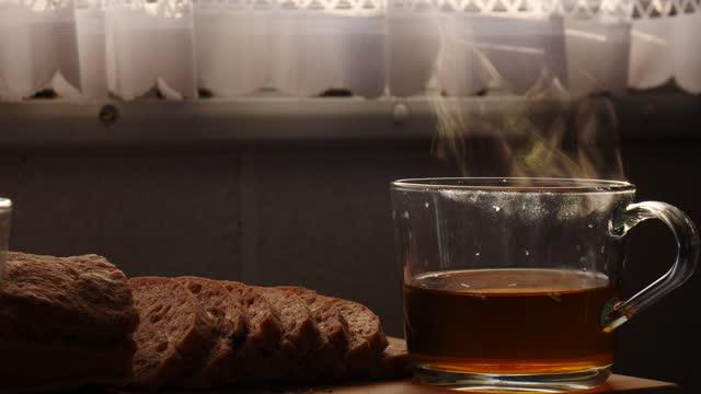 Steaming tea cup in caravan interior video