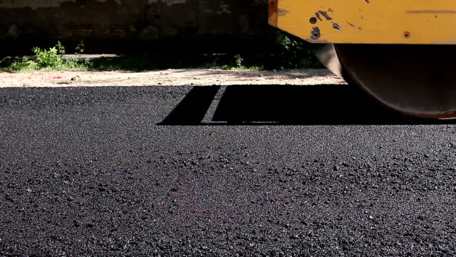 Steamroller are spreading, flatting hot asphalt. video