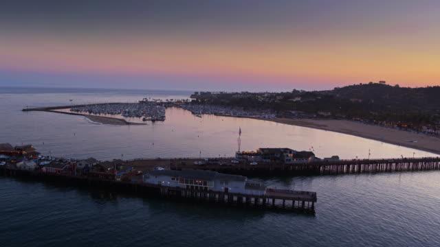 Stearns Wharf and Santa Barbara Marina at Twilight - Drone Shot video