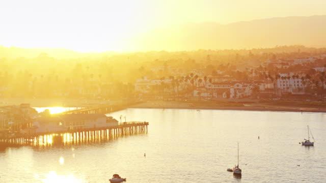Stearns Wharf, Santa Barbara and the Santa Ynez Mountains at Sunset - Drone Shot video