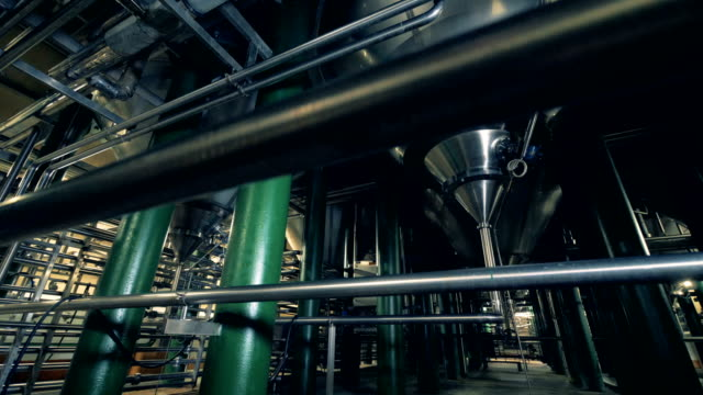 steel barrels and pipelines of a brewery plant - vodka video stock e b–roll